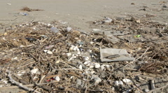 Rubbish and plastic on a beach Stock Footage