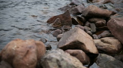Stones in the lake Stock Footage