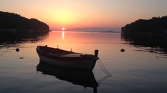 Sunset with a boat in Cavtat in Croatia Stock Footage
