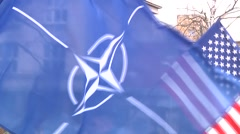 Nato and US Waving Flags Stock Footage