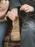 Close up of a man tying his boot laces. Stock Photos