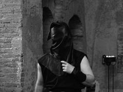 Executioner with black hood on his head in the castle Stock Photos