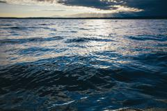 Sunset over the waters of the Puget Sound and Hood Canal at dusk. Stock Photos