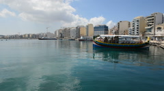 The traditional Maltese boat for tourists cruises, Sliema, Malta Stock Footage