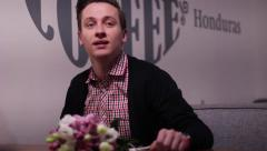 Young man waiting for his girlfriend or bride on a date with flowers Stock Footage