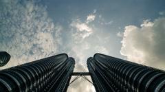 Low Angle Timelapse of Petronas Twin Tower in Kuala Lumpur, Malaysia Stock Footage