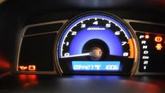 Close up of car dashboard and Odometer. (panning) - stock footage