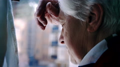Desperate thoughtful woman with his head on the window glass Stock Footage