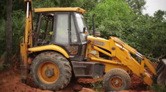 JCB Bulldozer tractor digging soil in India 1 Stock Footage