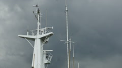 Shipboard radar antenna turns against a dark overcast sky - HD-P 0081 Stock Footage