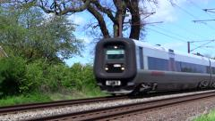 Oresund train on the coastal railway north of Copenhagen Stock Footage