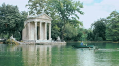 couple having an excursion on the lake with a rowboat in Rome, Villa borghese - stock footage