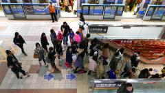 General view, metro platform, train doors closing, passengers crowd go down - stock footage