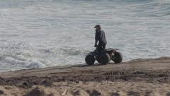 All Terrain Vehicle turning around on the sand Stock Footage