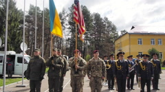 US and Ukrainian military are holding national flags Stock Footage