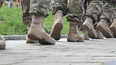 Stock Video Footage of US Marines boots marching to the barracks