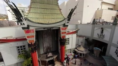 Aerial. Flying over Hollywood Boulevard and Chinese Theater. LA, California Stock Footage