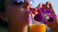 Smiling Woman Drinking Fresh Juice Outdoors. Slow Motion - stock footage