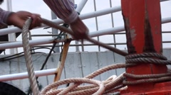 Folding Rope A Hank Cove Sails Away. Stock Video Footage Stock Footage