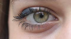 Young woman's eye: closeup portrait of a green eye Stock Footage