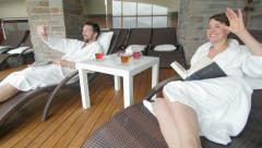 Couple relaxing and greeting in the spa Arkistovideo