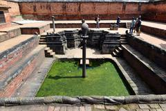 Ancient stone fountain In Bhaktapur, now damaged by the earthquake - stock photo