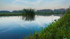 Typically Dutch canal in rural area with reflection of blue sky, Leiden, Holland Stock Footage
