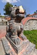 PASHUPATINATH - OCTOBER 10: Ancient stone fountain, now damaged after the ear - stock photo