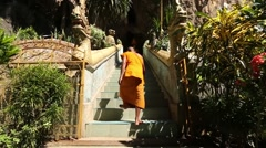 Slow Motion of Monk Walking Up Stairs Stock Footage