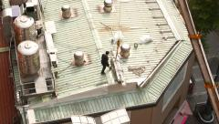Crane lifting down the materials from the roof, long shot Stock Footage