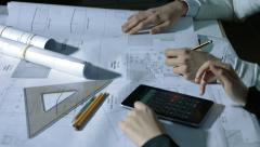 Architect working on a blueprint: colleagues checking the project Stock Footage