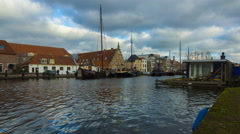 Harbor with old ships and 17th century wharf buildings in Leiden, Holland Stock Footage