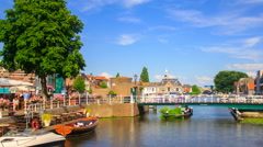 Stock Video Footage of Dutch city harbor with bridge, old houses, tourists and beautiful houses