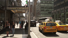 Taxi cabs at Bloomingdales Manhattan on a sunny day Stock Footage