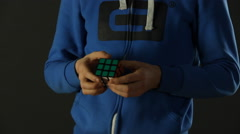 Mid Shot of solving Rubik's Cube puzzle Stock Footage