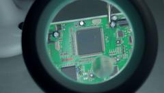 4K: Tilt Up Magnified View over Circuit Board - stock footage