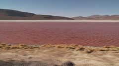 Red Lagoon in the Andes of Bolivia Stock Footage