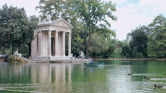 Rome, villa Borghese, romantic lake with lovers on the rowboat Stock Footage
