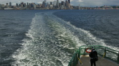 Ferry passenger taking photos of Seattle skyline receding - 4K UHD  0077 - stock footage