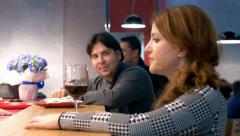 Man tries ti flirt with a woman who's drinking wine at the bar Stock Footage