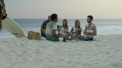 Stock Video Footage of Group of happy friends playing guitar and singing on Ipanema beach