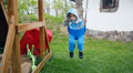 children's playground, kid baby child boy toddler on a swing HD Footage