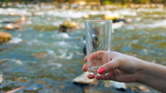 Glass of pure mineral water , mountain river Stock Footage