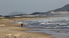 Surfer walking on Campeche beach Stock Footage