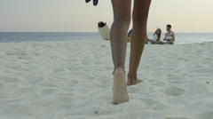 Young woman walking towards her group of friends singing on Ipanema beach - stock footage