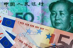 Chinese 50 Yuan and 50 euro bank notes - stock photo