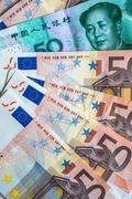 50 euro notes and 50 yuan note - stock photo