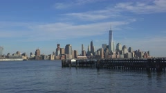 Old wooden pier of Hoboken Ferry Terminal with Lower Manhattan on background Stock Footage