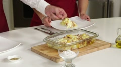 Serving casserole with potatoes and cheese - stock footage