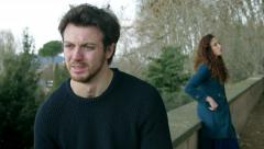 conflict and emotional stress in young people couple relationship outdoors - stock footage